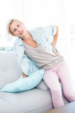 Blonde woman having backache Stock Photos