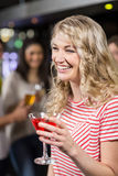 Blonde woman having cocktail with her friends Royalty Free Stock Image