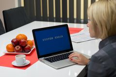 Blonde woman having a computer error Royalty Free Stock Images