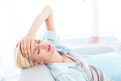 Blonde woman having headache Stock Images