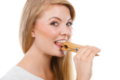 Blonde woman having tongue in clothespin Royalty Free Stock Photo