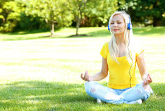 Blonde Woman with Headphone Meditating Outdoor Stock Photos