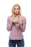 Blonde woman with her cellphone in studio Stock Photo