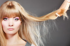 Blonde woman with her damaged dry hair. Royalty Free Stock Photos