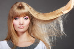 Blonde woman with her damaged dry hair. Stock Image