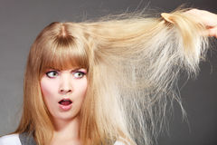 Blonde woman with her damaged dry hair. Stock Photo