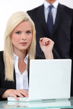 Blonde woman at her desk Stock Photos