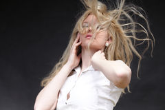 Blonde woman with her hair blowing Royalty Free Stock Photos
