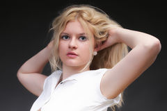 Blonde woman with her hair blowing Stock Images