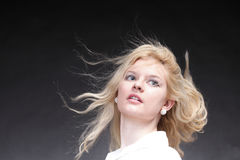 Blonde woman with her hair blowing Stock Photos