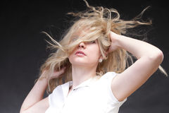 Blonde woman with her hair blowing Stock Photography