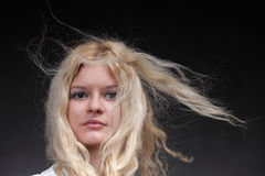 Blonde woman with her hair blowing Royalty Free Stock Photo