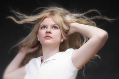 Blonde woman with her hair blowing Royalty Free Stock Photography