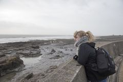 Blonde woman in her twenties at the beach. On a winters day Royalty Free Stock Images