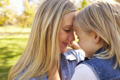 Blonde woman and her young daughter touching heads together Royalty Free Stock Photo