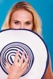Blonde woman hiding behind sun hat Royalty Free Stock Photo