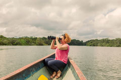 Blonde Woman With High Power Binocular. Happy Blonde Woman With High Power Binocular In Amazonian Jungle, National Park Cuyabeno, South America royalty free stock image