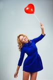 Blonde woman holding ballons royalty free stock photos