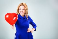 Blonde woman holding ballons Royalty Free Stock Photography