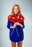 Blonde woman holding ballons Stock Photos