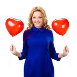 Blonde woman holding ballons Royalty Free Stock Images