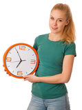 Blonde woman holding big clock in hand isolated over white. Royalty Free Stock Images