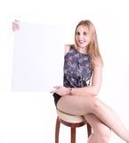 Blonde woman holding a blank card isolated on white background Stock Photos