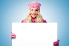 Blonde woman holding blank white paper. Over blue Stock Images