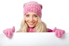 Blonde woman holding blank white paper Royalty Free Stock Images