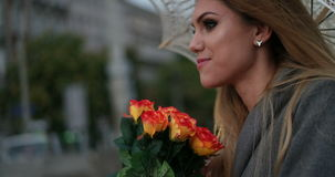 Blonde woman holding a bunch of roses stock video footage