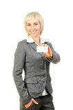Blonde woman holding a card Royalty Free Stock Photo