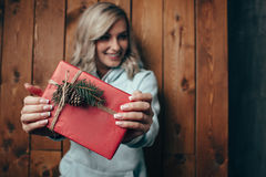 Blonde Woman Holding Christmas Gift Box Stock Photo