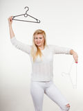 Blonde woman holding clothes hanger Stock Photo