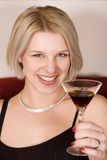 Blonde woman holding a cocktail glass Stock Photos