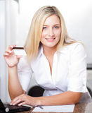 Blonde woman holding credit card Stock Photo