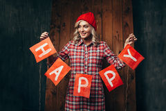 blonde woman holding flags wirh word happy Royalty Free Stock Photos