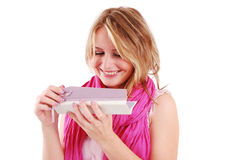 Blonde woman holding gift box Stock Images