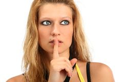 Blonde woman holding her finger to her lips Stock Images