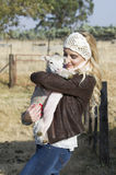 Blonde woman holding little lamb Royalty Free Stock Photo
