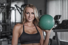 Blonde woman holding medicine ball Stock Photos