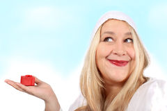 Blonde woman holding present Stock Photo