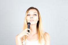 Blonde woman holding professional brush for blush. Make up artist. Stock Images