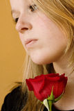Blonde Woman Holding Rose Royalty Free Stock Photos