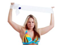 Blonde woman holding a sash Royalty Free Stock Photography