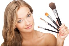 Blonde woman holding set of brushes Royalty Free Stock Image