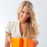 Blonde woman holding shopping bags Stock Images