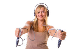Blonde woman holding skipping rope wearing headphones Stock Images