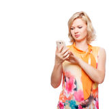 Blonde woman holding smartphone Stock Images