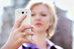 Woman holding smartphone Stock Image