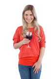 Blonde woman holding a wine glass Royalty Free Stock Photography